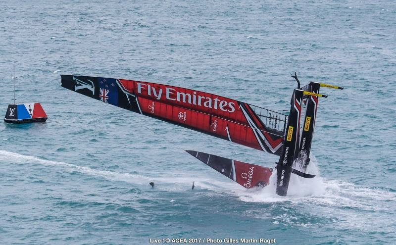Emirates Team New Zealand capsize on the second day of the Louis Vuitton America's Cup Challenger Playoffs - photo © ACEA 2017 / Gilles Martin-Raget