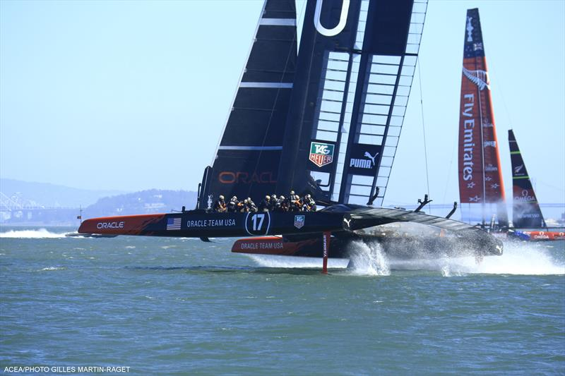 ORACLE TEAM USA win 34th America's Cup race 18 - photo © Gilles Martin-Raget / ACEA