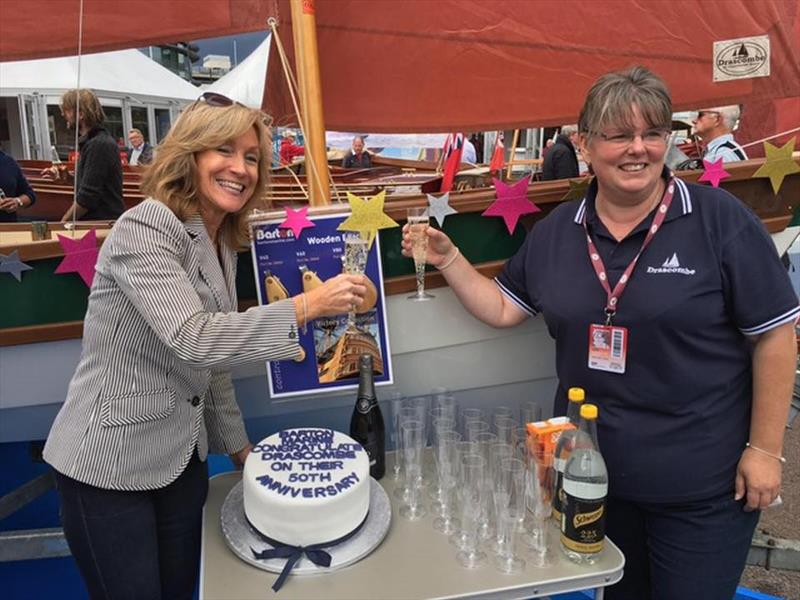 Barton Marine's Suzanne Blaustone toasts the Drascombe Lugger 50th Anniversary photo copyright Barton Marine taken at  and featuring the  class