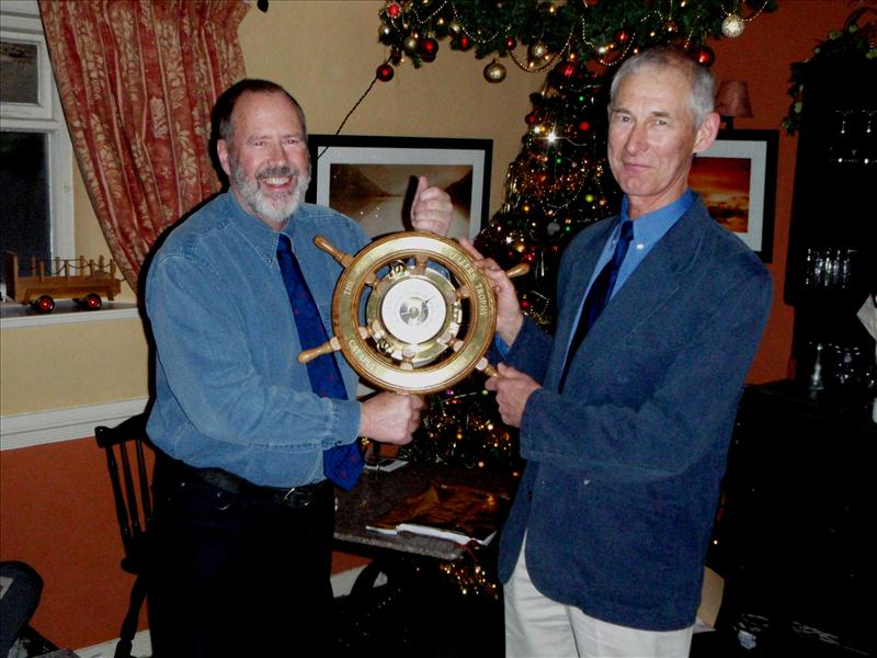 The Jon Montgomery Travellers Trophy is presented to 2011 Series victor Paul Ellis (right)