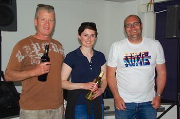 Rob Garcka and Abbey Jupp receive prizes from Club Commodore Tim Harris at the Dart 18 open meeting at Isle of Sheppey