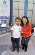 Xu Lijia with a young sailing fan on the Fernhurst Books stand at the RYA Suzuki Dinghy Show - photo © Rachel Atkins