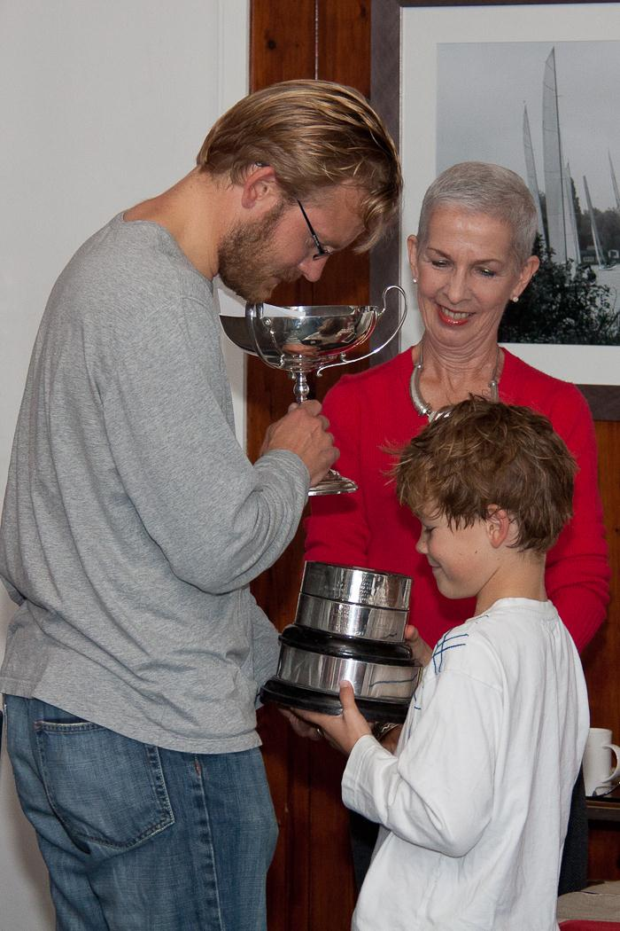 Vera Smith presents winners Angus and Arthur Cook with the trophy at the Upper Thames Firefly open photo copyright Tony Ketley taken at Upper Thames Sailing Club and featuring the Firefly class