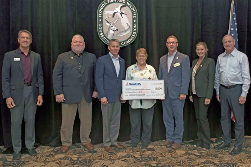 BoatUS representative Bonnie Basham (center) presents $5,000 check to FWC officials yesterday. Included (L to R) are A. Walker, Fish & Wildlife Foundation of Florida; and FWC Commissioners R. Harris, B. Rivard, M. Sole, S. Rood and R. Spotswood photo copyright BoatUS taken at  and featuring the Fishing boat class