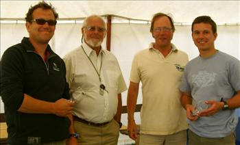 (L-R) Winning crew Chris Turner, commodore Roy Hulse, vice commodore John Robinson, winning helm Graham Vials