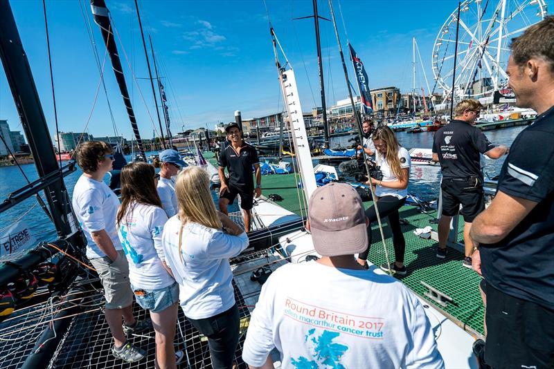 Team Oman Sail show the EMCT crew around their GC32 at the Extreme Sailing Series - photo © Ellen MacArthur Cancer Trust
