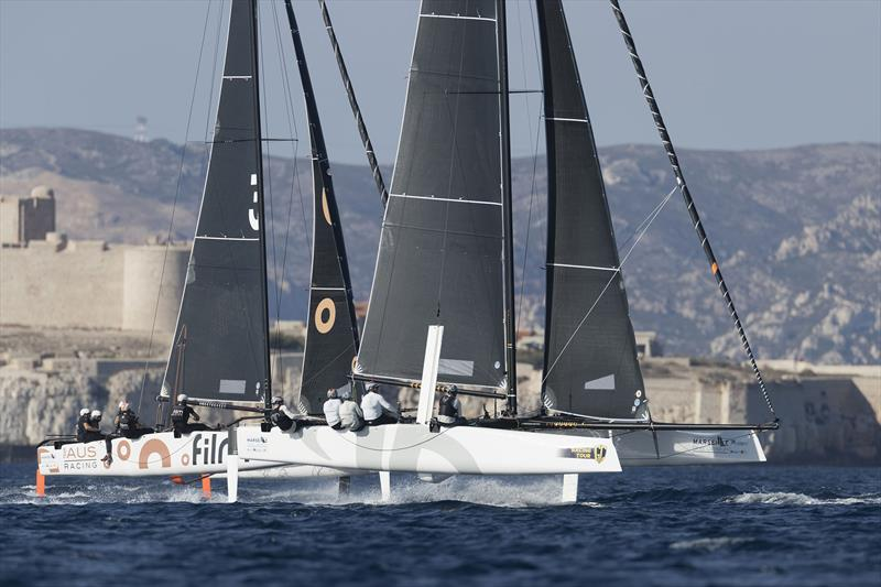 American Jason Carroll's Argo leads Simon Delzoppo's .film Racing from Australia in training on the Marseille One Design Practice Day - photo © Gilles Martin-Raget / GC32 Racing Tour