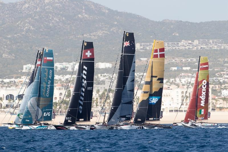The Extreme Sailing Series 2017. Act 8. 30th November- 3rd December 2017. Los Cabos Mexico, Cabo San Lucas Resort. Pictures of the fleet of race yachts crossing the start line on day 1 of racing close to Los Cabos - photo © Lloyd Images