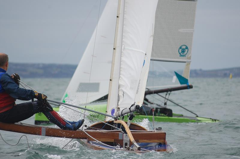 The international Canoes were strong on being inclusive for all genres of Canoe, including the older classics. Michael Briggs in a 50 year old woodie could often be seen mixing it with much more modern versions and he would also finish the windy races! - photo © David Henshall