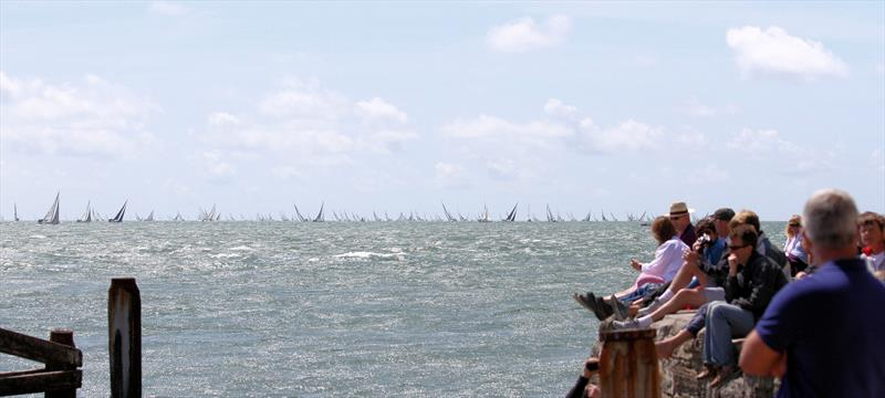 Crowds at Hurst Castle watching the huge fleet after the Rolex Fastnet Race start - photo © Mark Jardine / YachtsandYachting.com