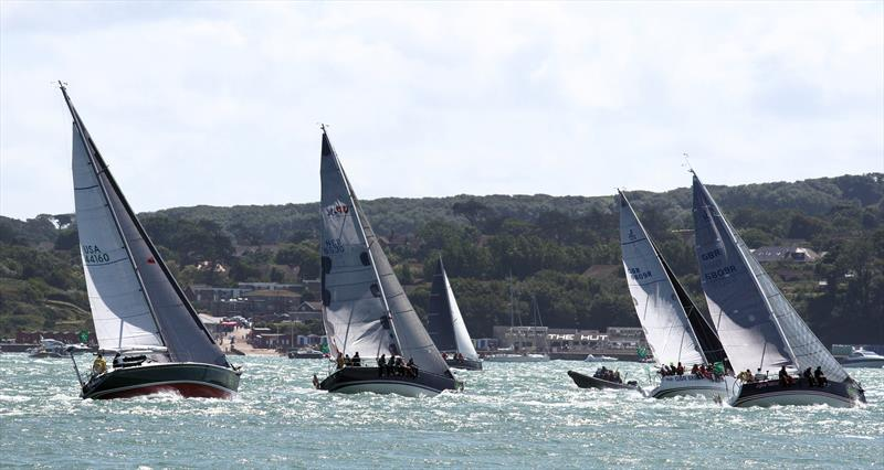 The multinational fleet passes The Hut after the Rolex Fastnet Race start - photo © Mark Jardine / YachtsandYachting.com