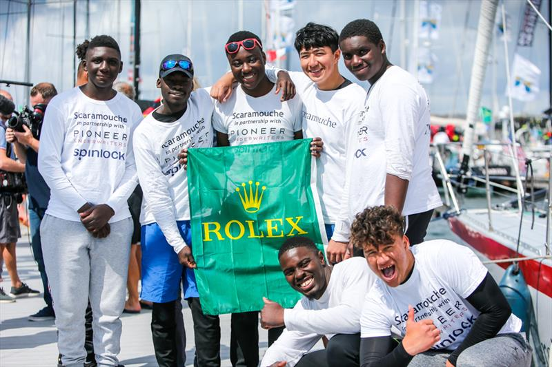 The Scaramouche team celebrate at the end of the Rolex Fastnet Race 2019 - photo © Paul Wyeth / www.pwpictures.com