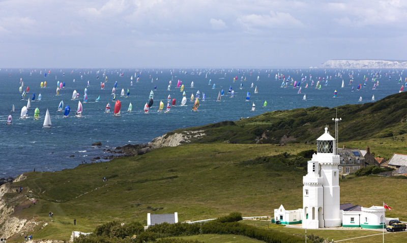 Part of the 1,750 boat fleet in the JPMorgan Asset Management Round the Island Race streams past Ventnor photo copyright TH Martinez / Sea&Co / onEdition taken at  and featuring the IRC class