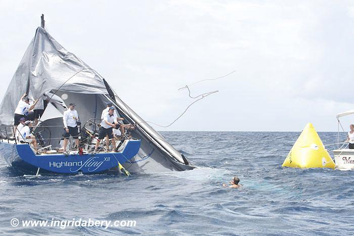 Highland Fling drops her rig on day 1 of the International Rolex Regatta photo copyright Ingrid Abery / www.ingridabery.com taken at St. Thomas Yacht Club and featuring the IRC class
