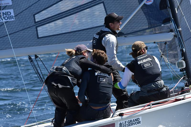 The winning skipper gets a hug from the one girl in the French crew - photo © Jane Austin
