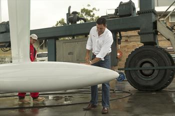 Mark Richards inspects Wild Oats XI's keel