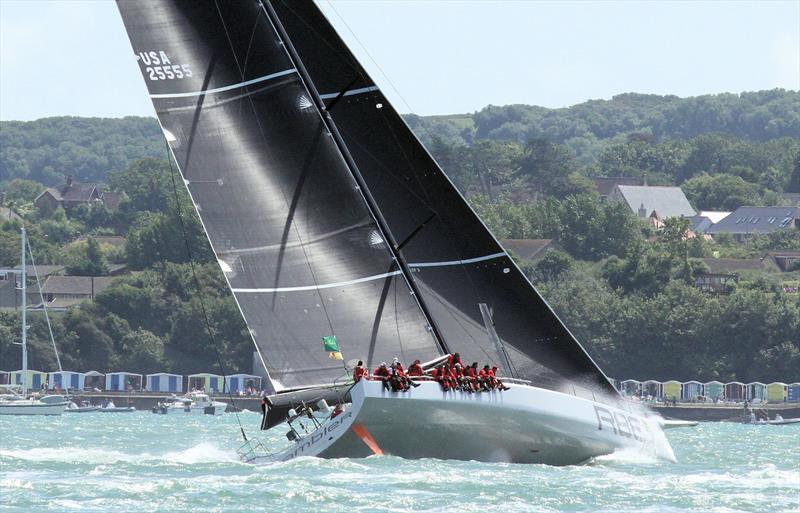 Rambler 88 passes Colwell Bay after the Rolex Fastnet Race start - photo © Mark Jardine / YachtsandYachting.com