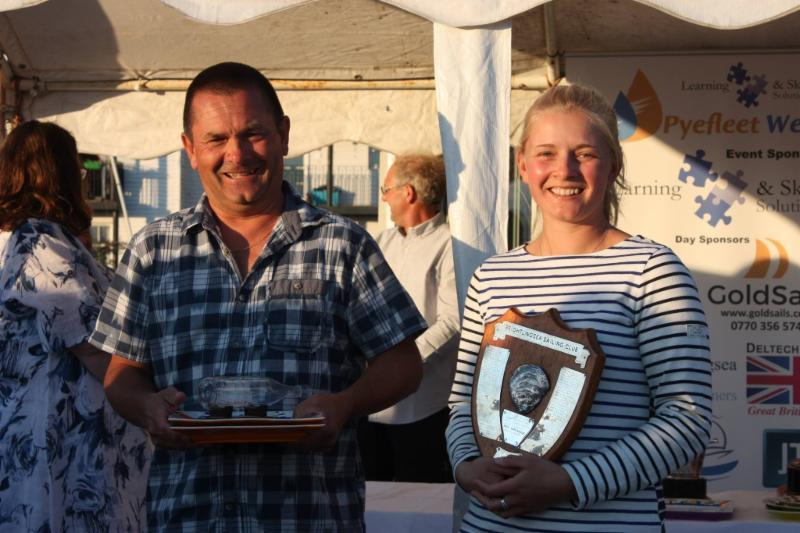Andy and Sarah Bines with the Fast Handicap and Merlin Rocket Trophies at Learning & Skills Solutions Pyefleet Week - photo © Mandy Bines
