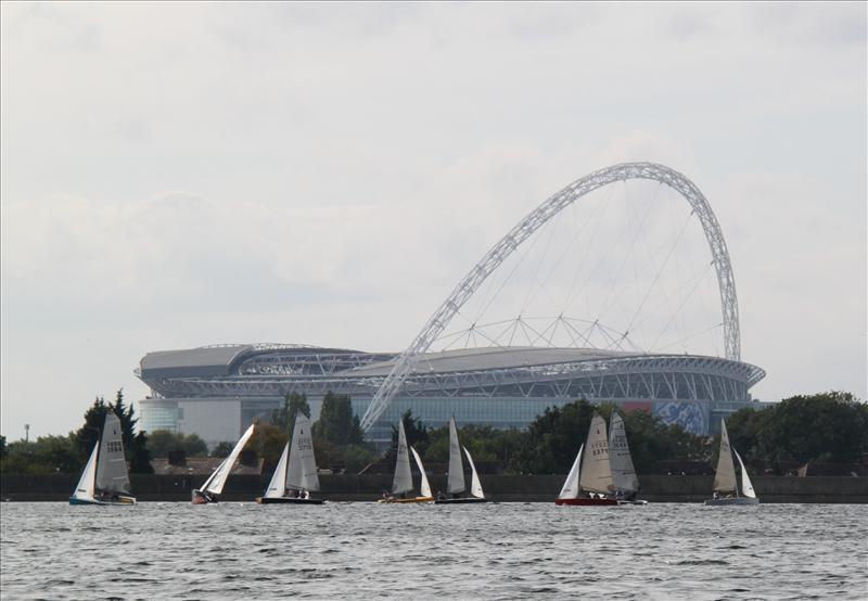 Merlin Rockets race beneath a view of Wembley Stadium