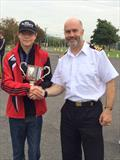Cadet Richardson with the Dawson Cup and the Captain of Sea Cadets - photo © Nigel Vick