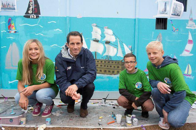 Admiral Lord Nelson School pupils and Sir Ben Ainslie pictured painting HMS Victory on the walls of the new Ben Ainslie Racing HQ today - photo © Mark Lloyd / www.lloydimages.com