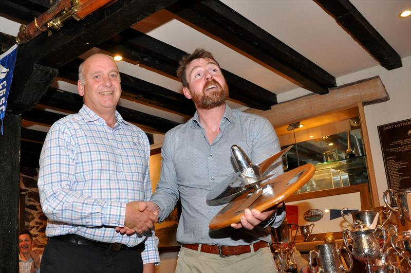 Donald MacKinnon was presented with the 'Kestrel Propeller for Outstanding Service to the Club' by Robbie Lawson, Commodore at the East Lothian Yacht Club Prize Giving photo copyright David Farmer taken at East Lothian Yacht Club