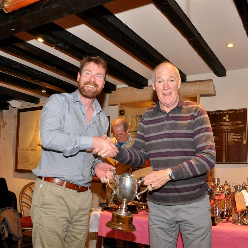 Jimmy Sandison was presented with 7 Trophies by Robbie Lawson, Commodore. Jimmy sails a Phantom dinghy at the East Lothian Yacht Club Prize Giving - photo © David Farmer