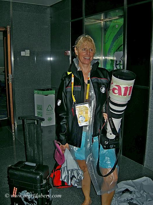 The glamourous side of sailing photography - Ingrid Abery on a very wet day in Qingdao! - photo © Ingrid Abery / www.ingridabery.com