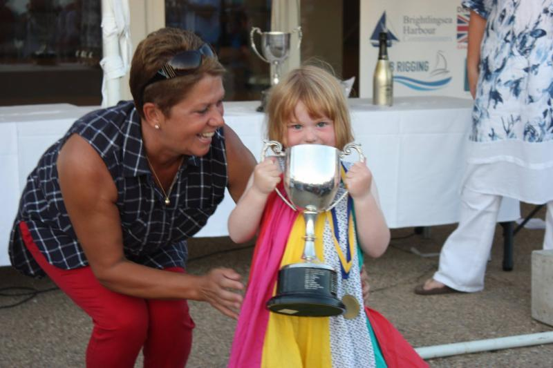 Sue Bouckley of Learning & Skills Solutions presents three year old Josie Heppell with her Youngest Crew trophy at Learning & Skills Solutions Pyefleet Week - photo © Mandy Bines