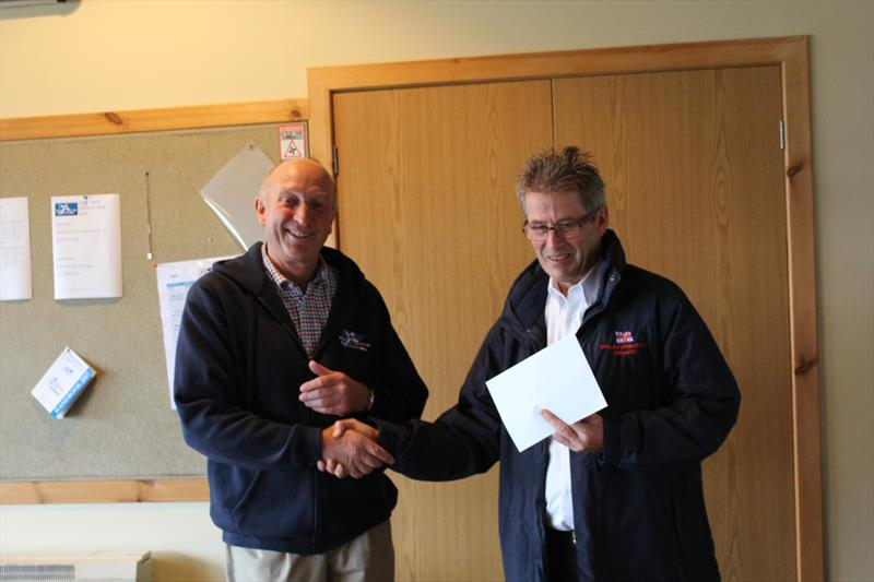 Solway Yacht Club Commodore, Ian Purkis, presenting the cheque for £1365 raised by the sailors in the RNLI Regatta Race to Gareth Jones, Kippford RNLI Operations Manager, at Solway YC Kippford Week - photo © Beatrice Overend