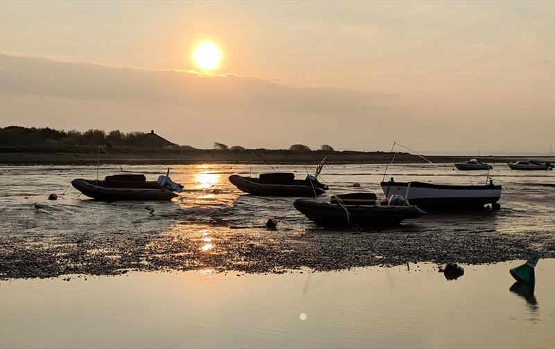 The Keyhaven YC rescue boats dry on their moorings at low tide over the Easter weekend - photo © Mark Jardine