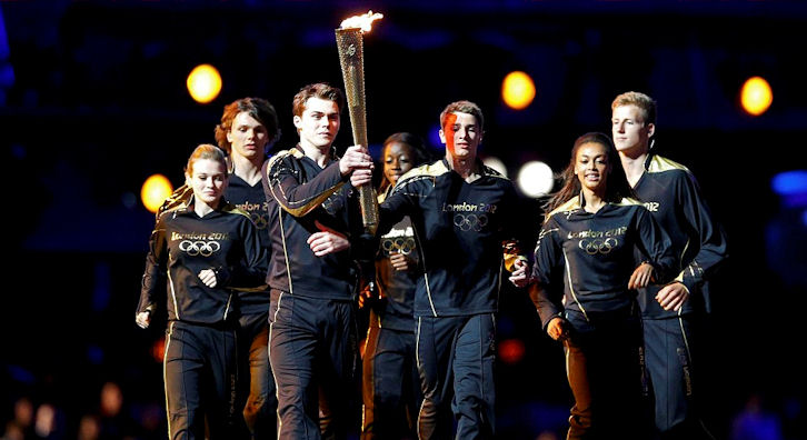 Callum Airlie represents sailing at the lighting of the Olympic Cauldron