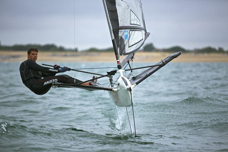 Rich Mason sailing his International Moth - photo © Musto