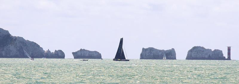 Hugo Boss passes the Needles after the Rolex Fastnet Race start - photo © Mark Jardine / YachtsandYachting.com