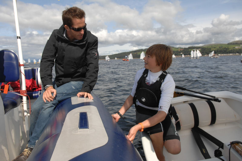 Ben Ainslie chats sailing with East Lothian's Callum Airlie on day 5 of the Volvo Musto Optimist nationals photo copyright Volvo taken at Largs Sailing Club and featuring the Optimist class