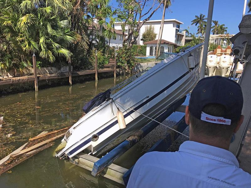 Boats damaged by Hurricane Irma, such as this vessel that fell off its lift and submerged the engine, are entering the used boat market photo copyright Scott Croft taken at  and featuring the Power boat class