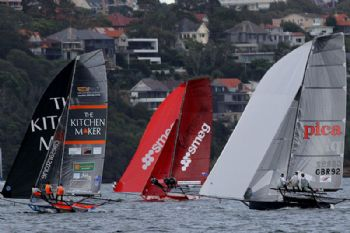 The UK's Pica with 2 local teams on the first spinnaker run in race 1 of the  64th JJ Giltinan Championship
