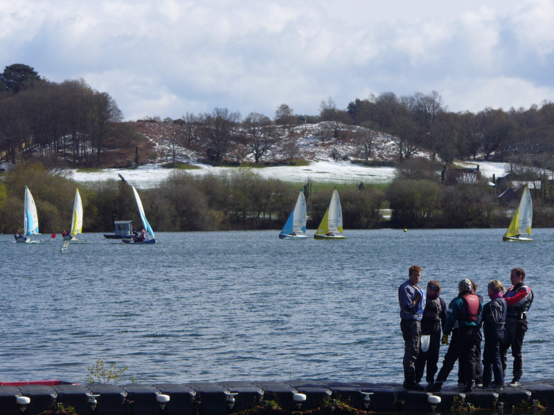 Snow on the hills as a backdrop for the team racing nationals at Spinnaker