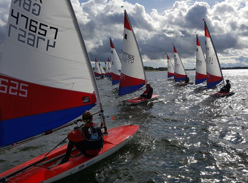 Charlie Turnbull, Kamran Ewbank, Annabell Turnbull & Jude Singleton lead the fleet away in the final race during the Topper Midlands Traveller Draycote photo copyright Midlands Topper Fleet taken at Draycote Water Sailing Club and featuring the Topper class