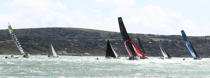 The Volvo Ocean Race fleet leaves the Solent after the Rolex Fastnet Race start - photo © Mark Jardine / YachtsandYachting.com
