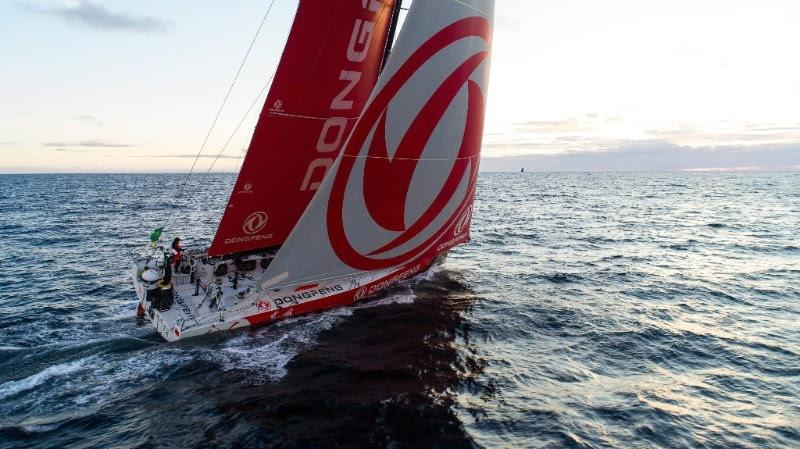 Dongfeng Race Team's VO65 round the Fastnet Rock in the Rolex Fastnet Race - photo © Jeremie Lecaudey / Volvo Ocean Race