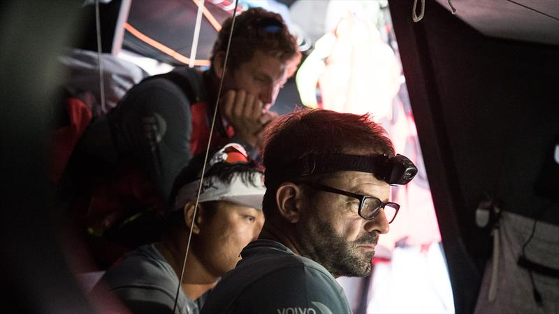 Crew looking frustrated around the Nav Station during Volvo Ocean Race Leg 1: Alicante to Lisbon - photo © Rich Edwards / Volvo Ocean Race