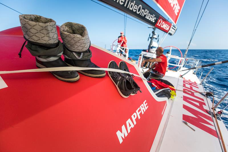 Onboard MAPFRE the sailors try and dry their boots whilst there are no waves crashing over the deck - photo © Ugo Fonolla / Volvo Ocean Race