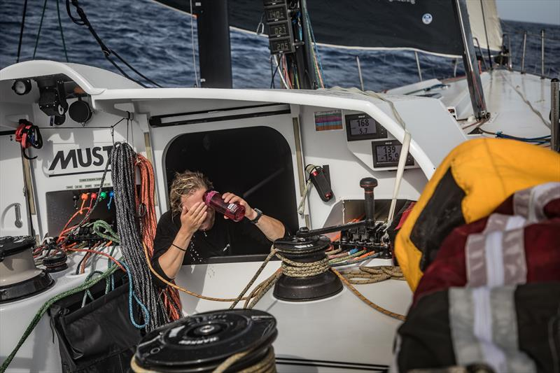 Onboard team Brunel British sailor Annie Lush rinses saltwater off her face - photo © Martin Keruzore / Volvo Ocean Race