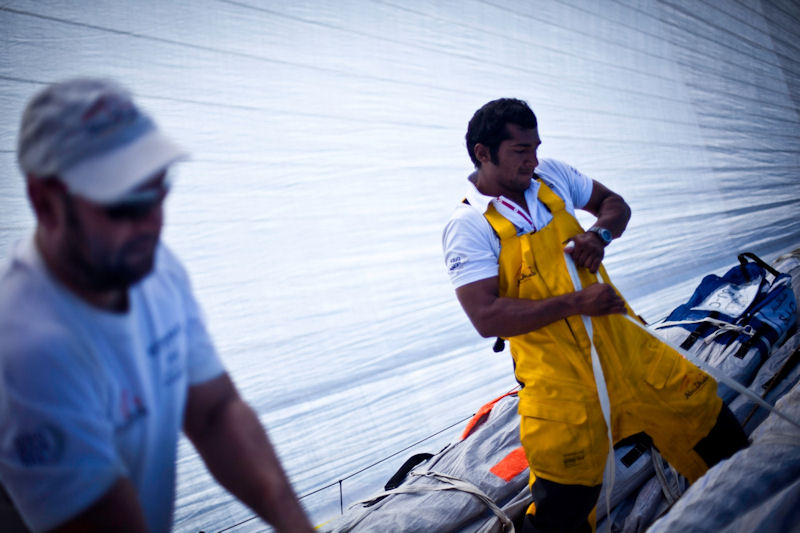 Adil Khalid puts straps on the old sail during a peel onboard Abu Dhabi Ocean Racing during leg 6 of the Volvo Ocean Race photo copyright Nick Dana/Abu Dhabi Ocean Racing/Volvo Ocean Race taken at  and featuring the Volvo 70 class