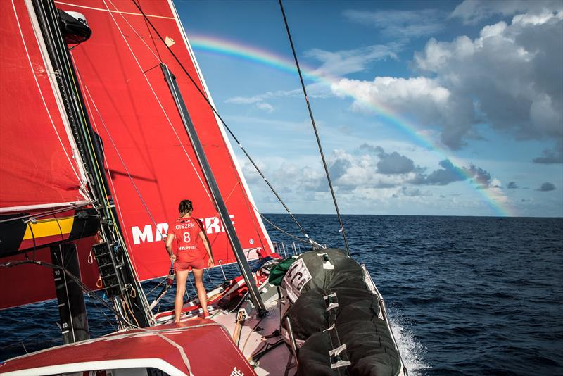 Leg 4, Melbourne to Hong Kong, day 12 on board MAPFRE Sophie Ciszek at the bow with a reinbow in the sky. photo copyright Ugo Fonolla / Volvo Ocean Race taken at  and featuring the Volvo One-Design class