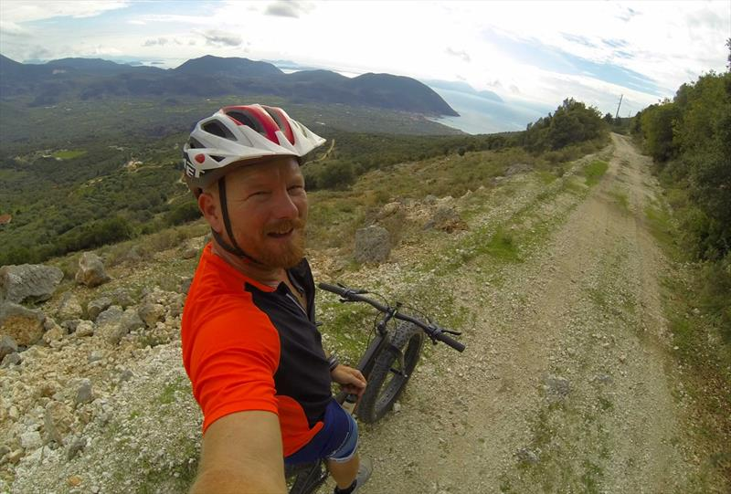 Joe out on his fat wheel mountainbike in Vassiliki - photo © Wildwind