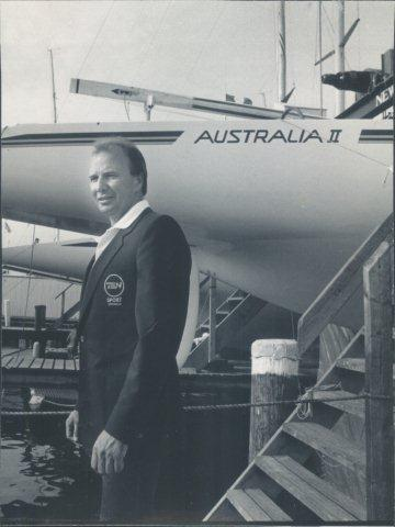 Rob Mundle with Australia II in his Channel 7 broadcasting jacket - photo © Archive