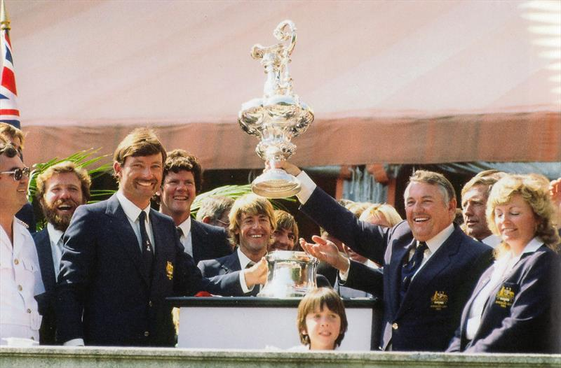 John Bertrand, helmsman of Australia II (left) whole syndicate head, Alan Bond holds the America's Cup aloft for all spectators and press members to see, from the lawn of the Vanderbilt's Marble House photo copyright Paul A. Darling taken at New York Yacht Club and featuring the 12m class