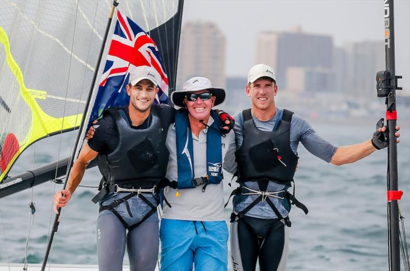 Blair Tuke (L) and Peter Burling (R) celebrate with Coach Hamish Wilcox - photo © Jesus Renedo / Sailing Energy / World Sailing